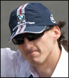Robert Kubica wears Oakley Sunglasses
