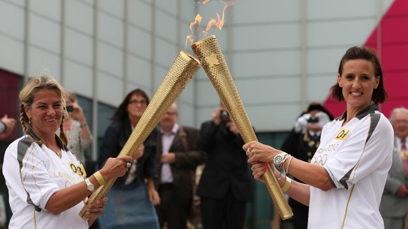 Tracey Emin hands flame over to Karen Pickering