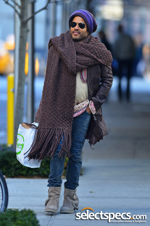 Lenny Kravitz wearing Aviator Sunglasses and a carpet off-cut for a scarf.