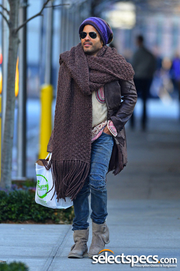 Lenny Kravitz wearing Aviator Sunglasses and a carpet off-cut for a scarf