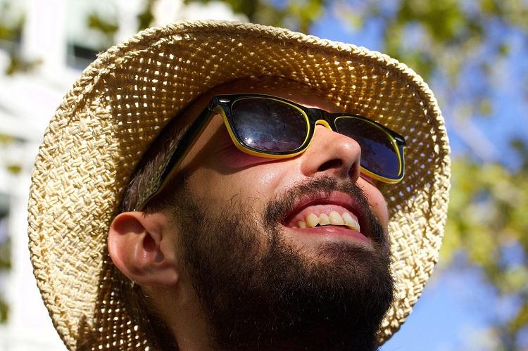 wearing sunglasses an make you feel happier