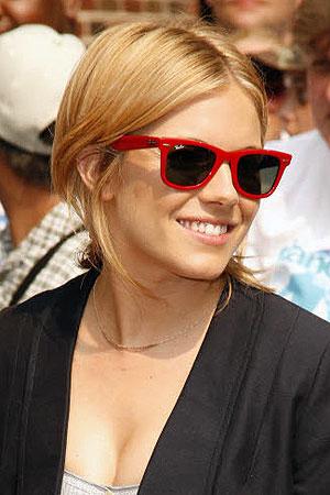 Sienna Miller wearing red sunglasses