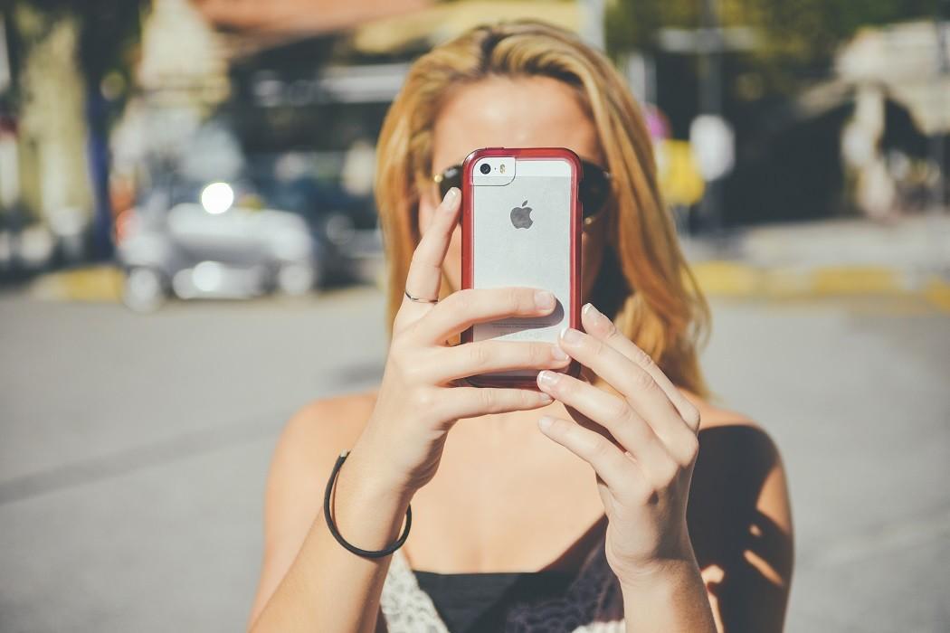 woman taking selfie in glasses