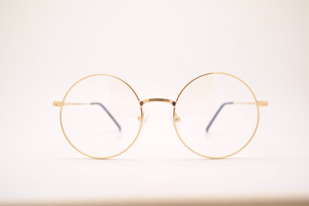 Gold rimmed round glasses