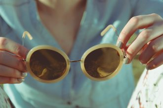 sunglasses and blue nailpolish