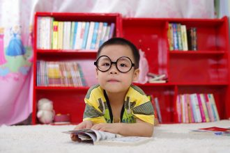 little boy in glasses