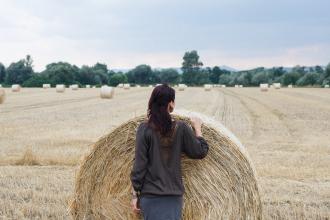 Woman in hay field